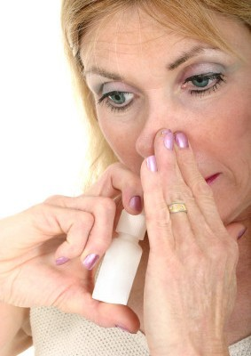 Woman Using Asthma Inhaler with Hand
