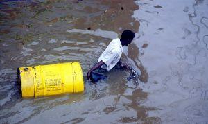 A man walking through floodwater